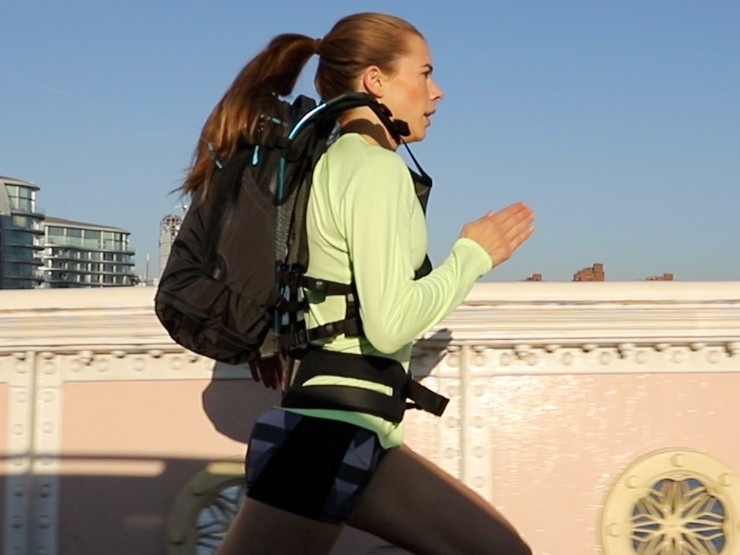 Woman running in weightless feeling rucksack